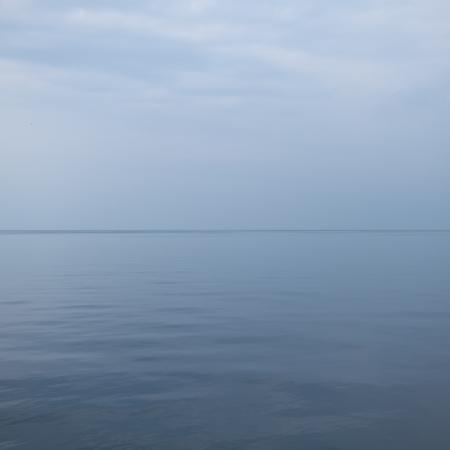 still water: calm sea with gray sky