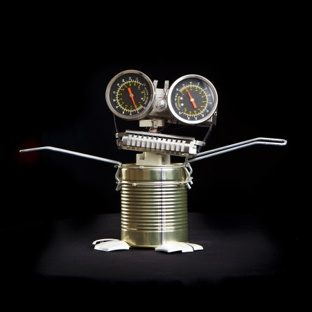 cute funny robot toy made of garbage. recycling waste photo