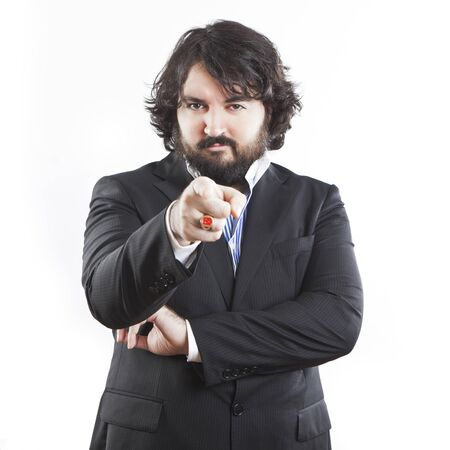 portrait of young businessman with beard pointing at you photo