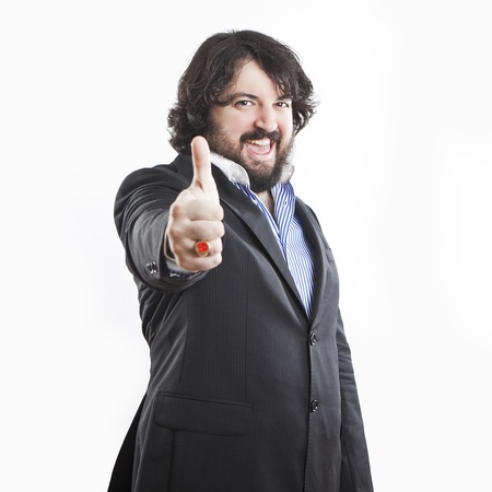 portrait of positive businessman with beard, thumb up photo