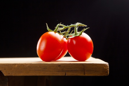 fresh ripe cherry tomato on wooden table photo