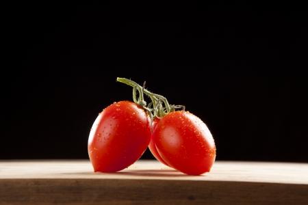 fresh ripe cherry tomato on wooden table photo