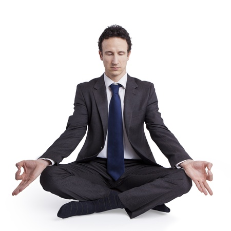 young businessman meditating in yoga lotus pose on white background Stock Photo - 18691870