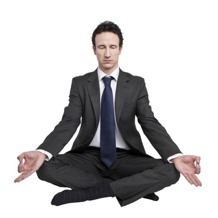 young businessman meditating in yoga lotus pose on white background Stock Photo - 18691861