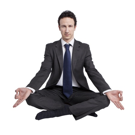 young businessman meditating in yoga lotus pose on white background Stok Fotoğraf - 18691853
