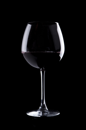 elegant galss of red wine on black background