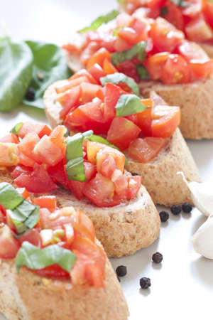 Crostini with tomato, oil, basil and garlic Stock Photo