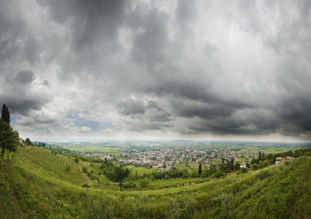 wheather: scenic view of stormy wheather on small city in italy, cormons