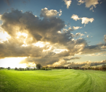 beautiful sunset on a golf field photo