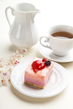 pink cake: beautiful pink berries pastry, little cake with tea