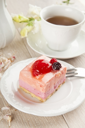 beautiful pink berries pastry, little cake with tea photo