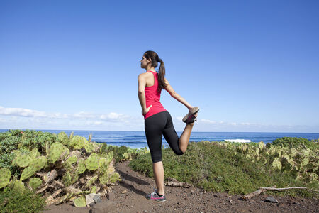 Young woman stretching before running outdoor