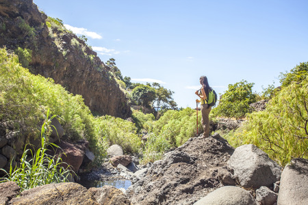 canary island: young woman hiking in tropical nature