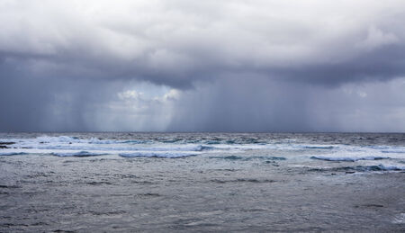 stormy sea: stormy weather on the ocean, rain over the sea