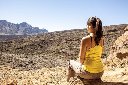 wild canary: young woman enjoyng a beautiful desert scenic view Stock Photo