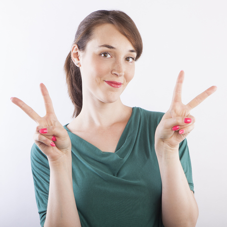 young beautiful woman  making victory sign photo