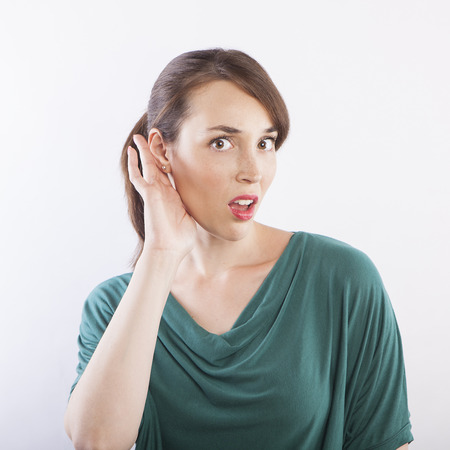 young beautiful woman listening, what?! face expression Stock Photo