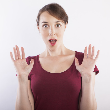 surprise face: young beautiful woman surprise face expression Stock Photo