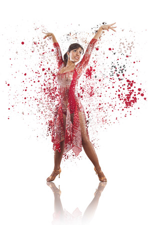 dispersion: elegant beautiful woman latin dancer performing on black background, dispersion effect Stock Photo