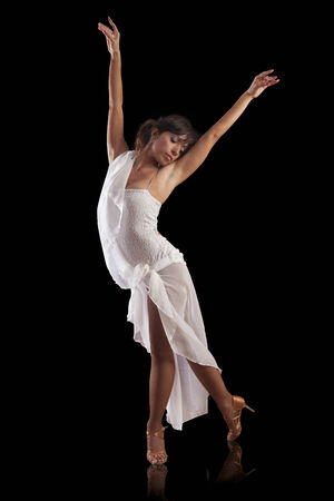elegant beautiful woman latin dancer performing on black background