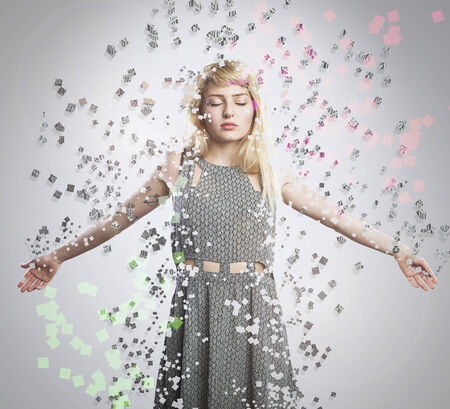 dispersion: artistic portrait of a young beautiful blonde woman, explosion dispersion effect Stock Photo
