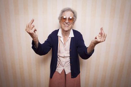 cool elder lady making middle finger sign Stock fotó