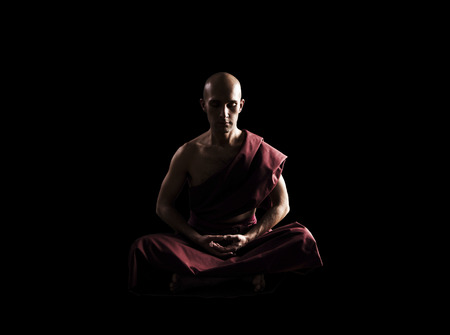 buddhist monk in meditation pose over black background Imagens - 34827241