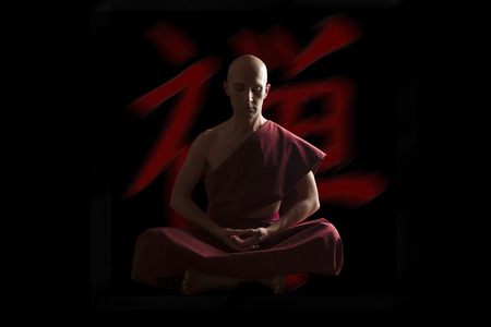 ideogram: buddhist monk in meditation pose  with zen symbol on the background