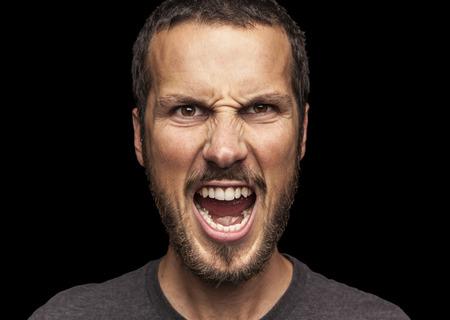 portrait of a young beautiful man screaming Standard-Bild
