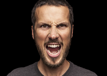 portrait of a young beautiful man screaming Stockfoto