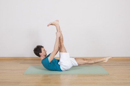 34: man practicing pilates indoor, return to life sequence, 34 exercise
