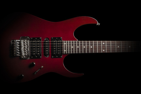 electric guitar: electric guitar on black background Stock Photo