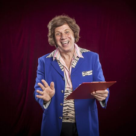 courtain: showman, entertainer funny face expression on red courtain background Stock Photo