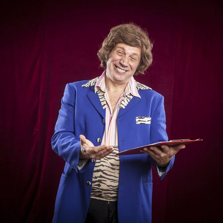 showman: showman, entertainer funny face expression on red courtain background Stock Photo