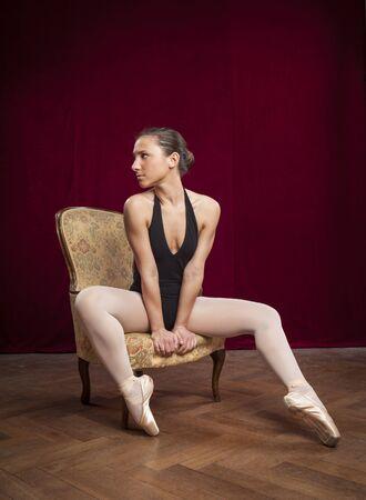 velvet background: young beautiful ballet dancer on red velvet background Stock Photo