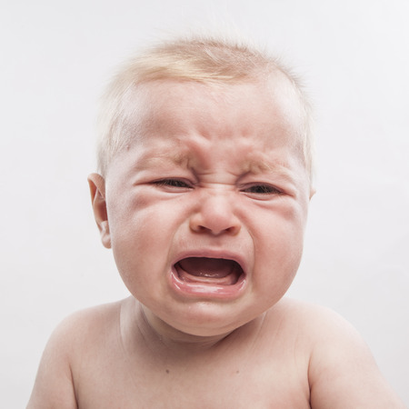 sad cute baby: portrait of a cute newborn baby crying