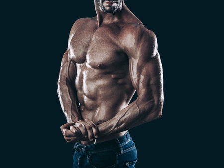 sexy abs: muscle man torso on black background, bodybuilding athlete portrait