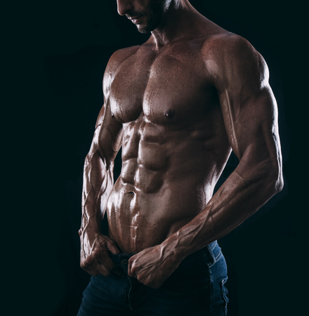 muscle man torso on black background, bodybuilding athlete portrait
