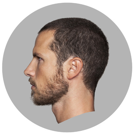 man head: coin like portrait of an handsome young man profile Stock Photo