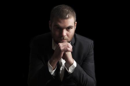 tough: portrait of a tough cool man on balck background