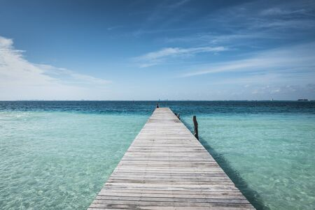 blue sea: wooden dock into blue tropical sea in Isla Mujeres, Yucatan Mexico