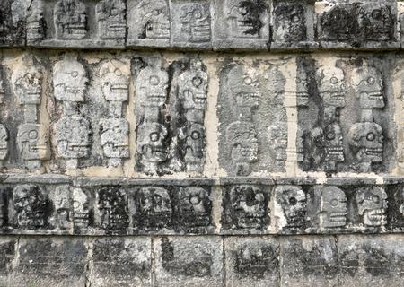 itza: skulls sculpture detail in chichen itza mexico