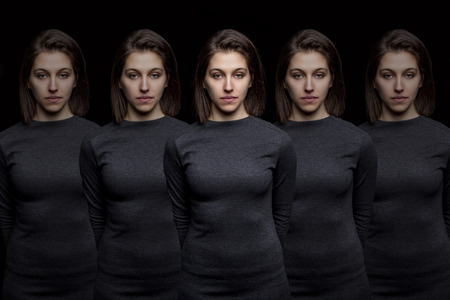 clones: Group of young pretty women clones standing in a row
