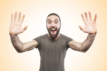 surprised man: portrait of surprised man funny face expression Stock Photo