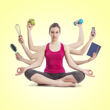 tasking: multi tasking woman portrait in yoga position with many arms Stock Photo