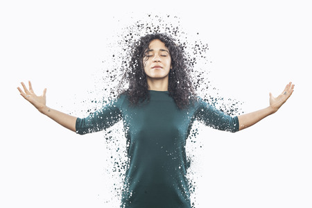 dispersion: artistic portrait of a young beautiful woman, explosion dispersion effect Stock Photo