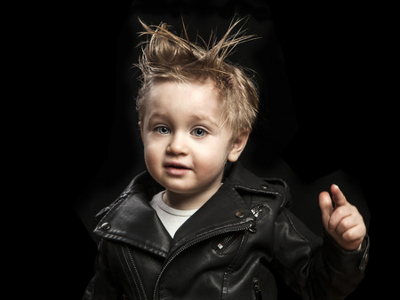 portrait of adorable young boy in leather jacket 版權商用圖片