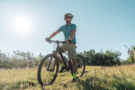 Man riding his mountain bike outdoor in nature