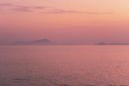 The islands of Ischia and Procida in Italy view from the sea at sunset Stock fotó