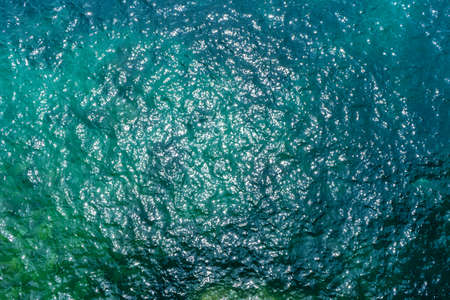 Sunny blue sea surface from above